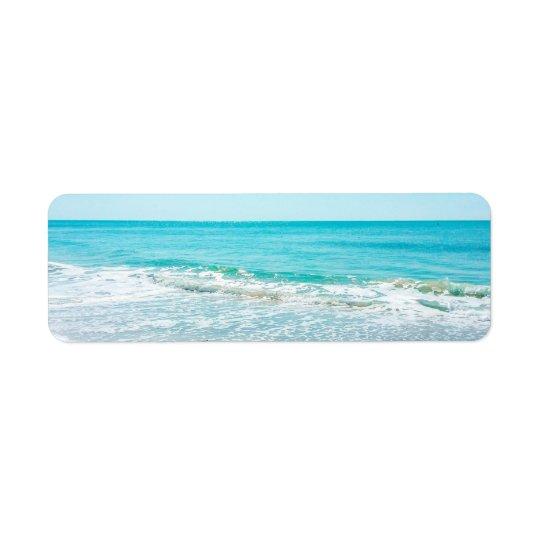 熱帯フロリダのビーチの砂の海洋波のシギ ラベル