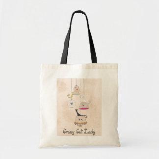 熱狂するな猫の女性鳥かごの蝶トートバック トートバッグ