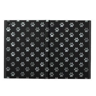 犬の足のプリントの銀製灰色の黒の背景