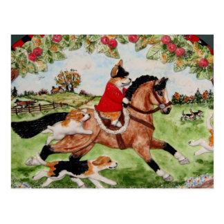 猟犬へのコーギーの猟師の乗車 ポストカード