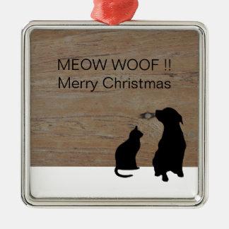 猫犬のイラストレーションはクリスマスのシルエットを描きます メタルオーナメント
