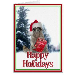 現在を持つクリスマスの強盗のアライグマ カード