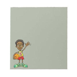 球を握っている男の子の漫画の絵 ノートパッド