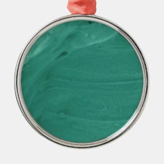 甘いティール(緑がかった色)のアイシングの写真撮影 メタルオーナメント