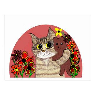 甘いテディベアを保持するかわいい漫画の子猫 ポストカード