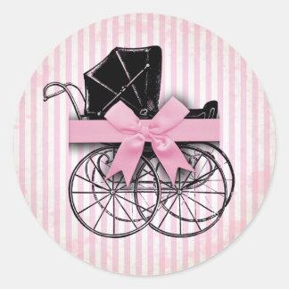 甘いピンクのヴィンテージの乳母車の手押車および弓 ラウンドシール