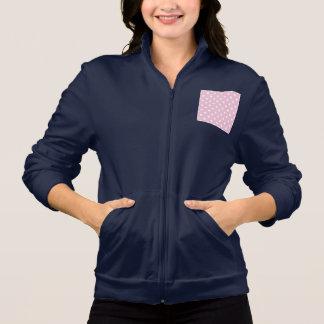 甘いピンクの背景のジャケットの水玉模様