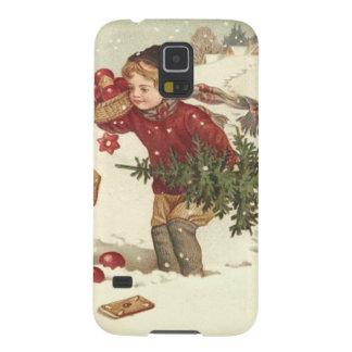 男の子のクリスマスツリーはコテージの雪を示します GALAXY S5 ケース