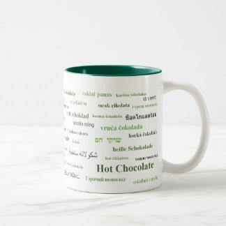 異なった言語(緑)のココアのマグ ツートーンマグカップ