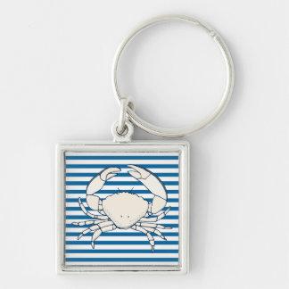 白いカニの青および白い横のストライプ キーホルダー