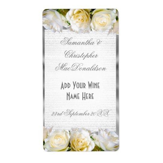 白いバラの花柄および銀製結婚式のワイン・ボトル ラベル