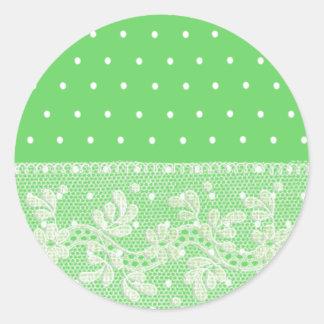 白い点および花のレースとのかわいく柔らかい緑 ラウンドシール