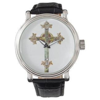 白い背景の金ゴールドの十字 腕時計