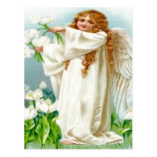 白い花を握るヴィンテージの天使 ポストカード