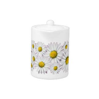 白くおよび黄色のデイジーの花パターン