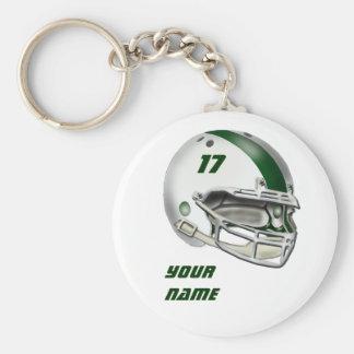 白く、深緑色のフットボール用ヘルメット ベーシック丸型缶キーホルダー
