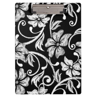 白によって印刷されるハイビスカスの刺繍 クリップボード