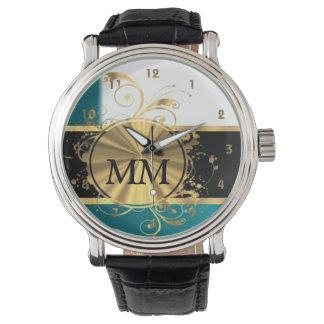 白のティール(緑がかった色)の青そして金ゴールドのモノグラム 腕時計
