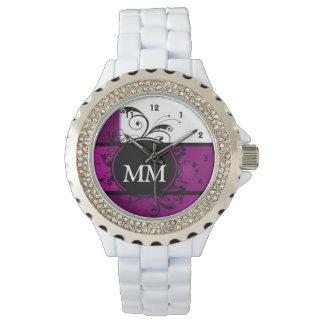 白の紫色および黒いモノグラム 腕時計