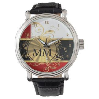 白の赤および金ゴールドのモノグラム 腕時計