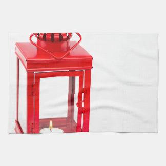 白の非常に熱いtealightが付いている赤いランタン キッチンタオル