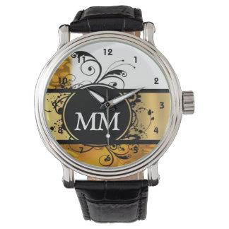 白の黄色および黒いモノグラム 腕時計