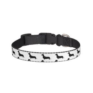 白または色のダックスフントの黒いシルエット ペット首輪