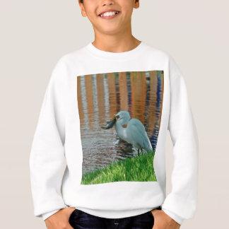 白鷺および捕獲物 スウェットシャツ
