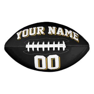 白黒および金ゴールドの習慣のフットボール アメリカンフットボール