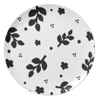 白黒葉および花のシルエット プレート
