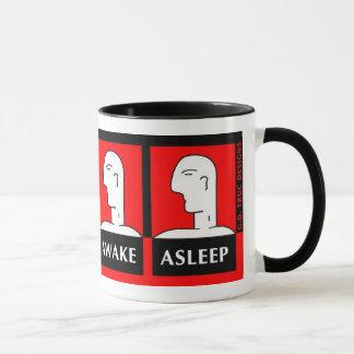 目がさめている眠った マグカップ