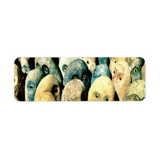 目が付いている涼しい石の石のフクロウの顔 ラベル