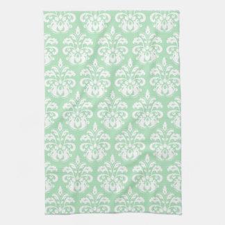 真新しい緑および白いダマスク織 キッチンタオル