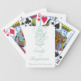 真新しい緑の鳥籠の結婚式の一流の遊ぶカード バイスクルトランプ