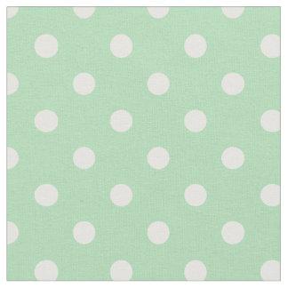 真新しい緑及び白は の生地に点を打ちます ファブリック