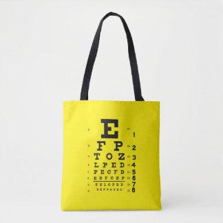 眼科学のポップアートのレトロのスタイルの視力検査表の黄色 トートバッグ