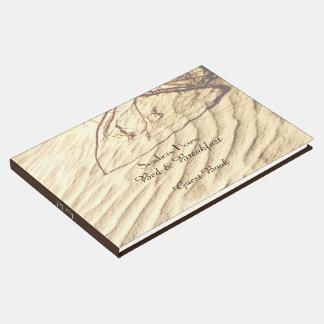 砂のベッド及び朝食B&Bの来客名簿のさざ波 ゲストブック