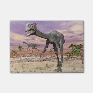 砂漠のGigantoraptorの恐竜- 3Dは描写します ポストイット