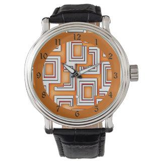 種族の刺激を受けたなオレンジ及び白い四角のパターン 腕時計