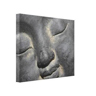 穏やかな仏は石造りの彫刻に直面します キャンバスプリント