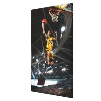 空気で跳んでいるバスケットボール選手 キャンバスプリント