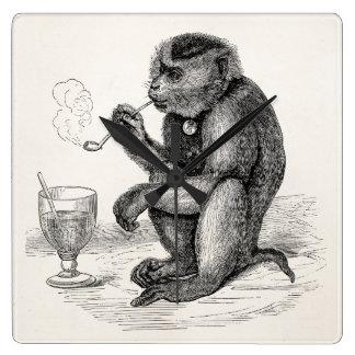 管を煙らしているヴィンテージ猿は動物をまねます スクエア壁時計