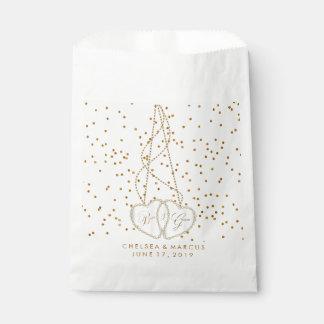 紙吹雪の金ゴールドの点および美しいダイヤモンドのハート フェイバーバッグ
