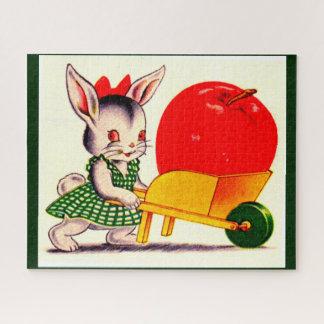 素晴らしく大きいりんごが付いているカートを押す少しバニー ジグソーパズル