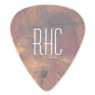 素朴で男らしい木製の節玉の丸太の切れの切り株の一見 ホワイトデルリン ギターピック