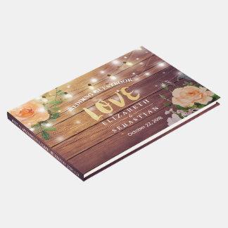 素朴な木製の花のひもは結婚式のゲストブックをつけます ゲストブック