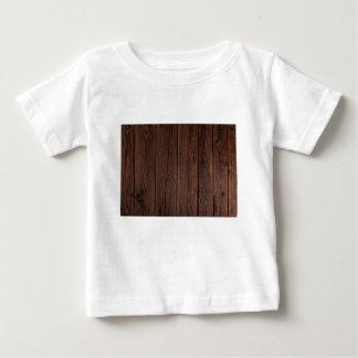 素朴な焦茶の木製の木の塀の国スタイル ベビーTシャツ