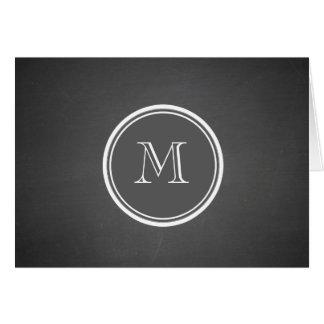 素朴な黒板の背景のモノグラム カード