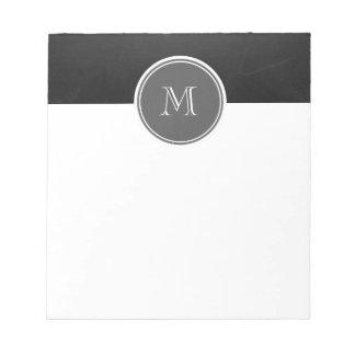 素朴な黒板の背景のモノグラム ノートパッド