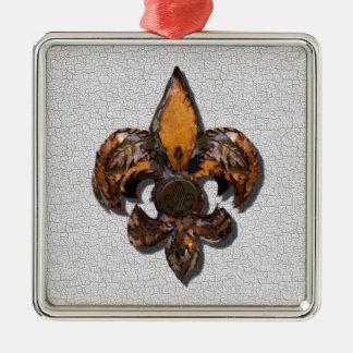 素朴な(紋章の)フラ・ダ・リのパチパチ鳴る音の背景 メタルオーナメント